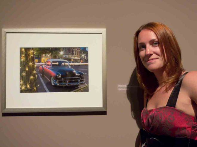 Caitlin Londa and her photograph in the SUNY exhibit.