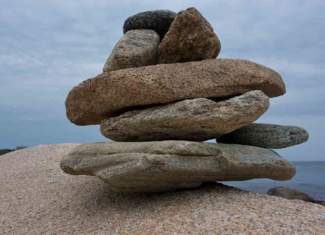 Beach rocks stacked in a cairn.